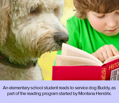 Boy reading to labradoodle