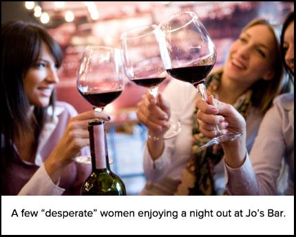 Happy women toasting with wine