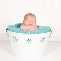 Baby Hendrix in a snow bucket