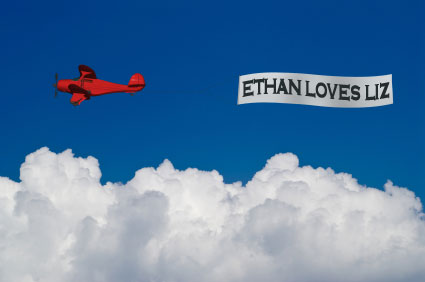 Plane with banner that says Ethan loves Liz