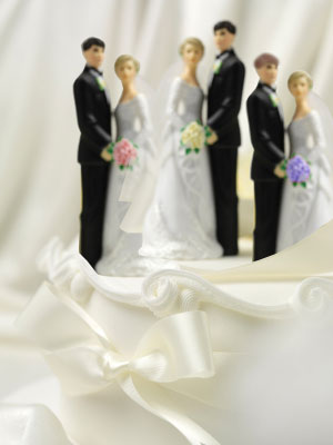 Three identical wedding cake toppers
