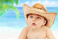Baby Wyatt on beach in cowboy hat